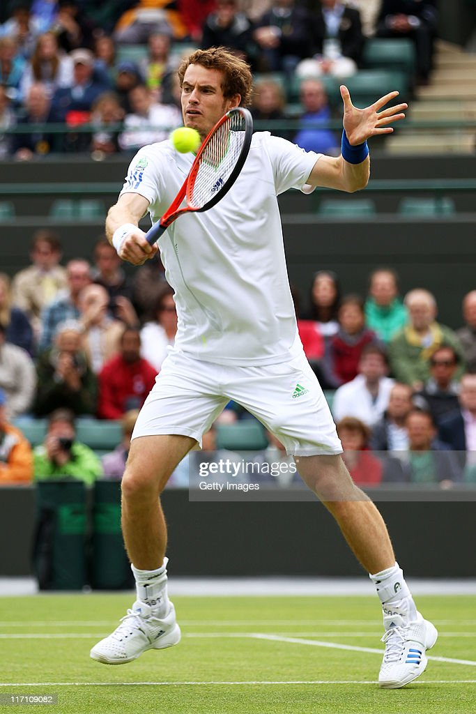 <a gi-track='captionPersonalityLinkClicked' href=/galleries/search?phrase=Andy+Murray+-+Tennis+Player&family=editorial&specificpeople=200668 ng-click='$event.stopPropagation()'>Andy Murray</a> of Great Britain returns a shot during his second round match against Tobias Kamke of Germany on Day Three of the Wimbledon Lawn Tennis Championships at the All England Lawn Tennis and Croquet Club on June 22, 2011 in London, England.