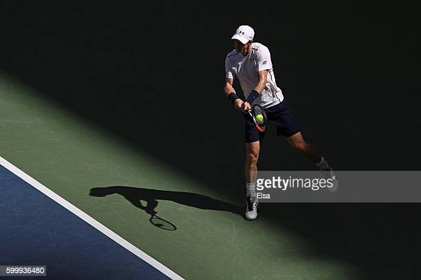 Andy Murray of Great Britain returns a shot to Kei Nishikori of Japan during their Men's Singles Quarterfinal match on Day Ten of the 2016 US Open at...