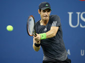 Andy Murray of Great Britain returns a shot to Novak Djokovic of Serbia during their men's singles quarterfinal match on Day Ten of the 2014 US Open...