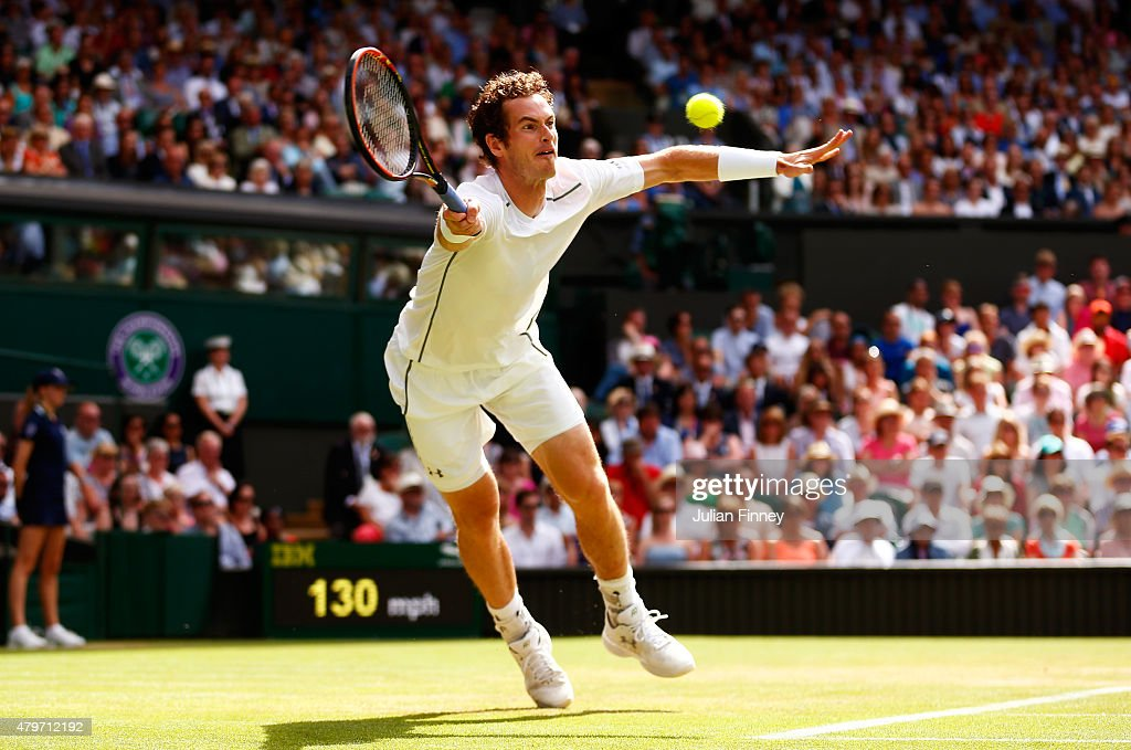 Andy Murray of Great Britain returns in his Gentlemen's Singles Fourth Round match against Ivo Karlovic of Croatia during day seven of the Wimbledon...