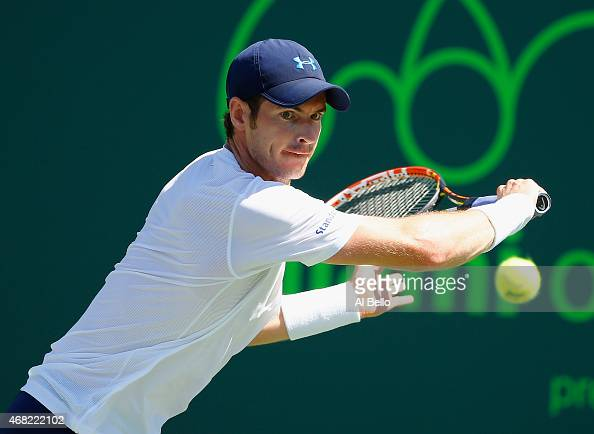 Andy Murray of Great Britain returns the ball against Kevin Anderson of South Africa during day 9 of the Miami Open at Crandon Park Tennis Center on...