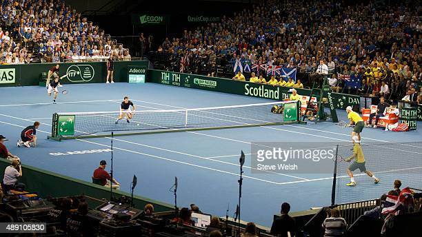 Andy Murray of Great Britain returns to Sam Groth of Australia during day 2 of the Great Britain v Australia Davis Cup Semi Final 2015 at the...