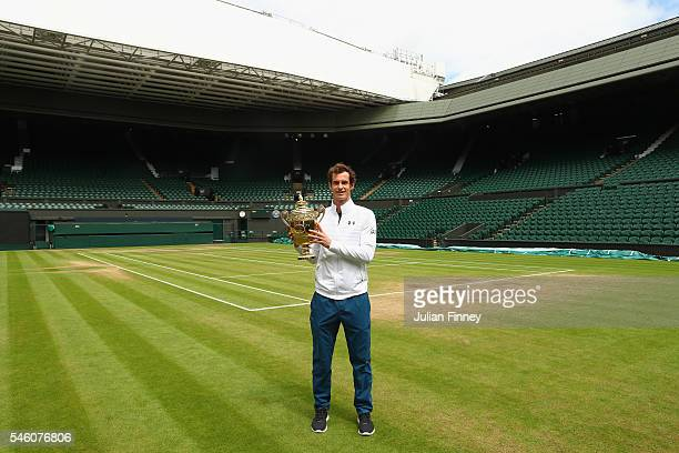 Andy Murray of Great Britain revisits centre court with the trophy at Wimbledon on July 11 2016 in London England