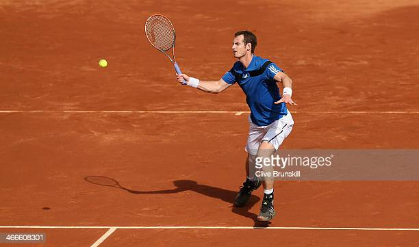 Andy Murray of Great Britain runs in to play a forehand volley against Sam Querrey of the United States during day three of the Davis Cup World Group...