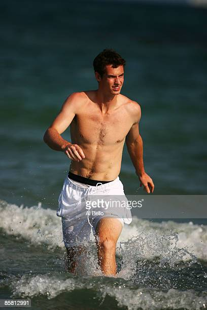 Andy Murray of Great Britain runs out of the water for photographers after defeating Novak Djokovic of Serbia to win the men's final of the Sony...