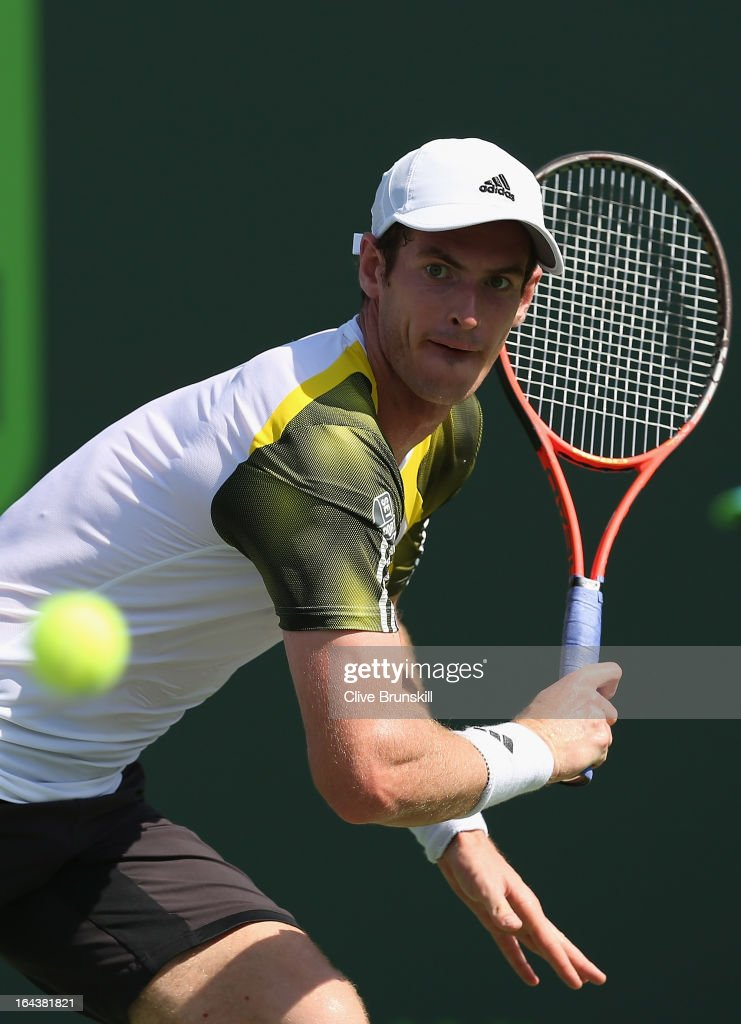 Andy Murray of Great Britain runs to play a backhand against Bernard Tomic of Australia during their second round match at the Sony Open at Crandon Park Tennis Center on March 23, 2013 in Key Biscayne, Florida.