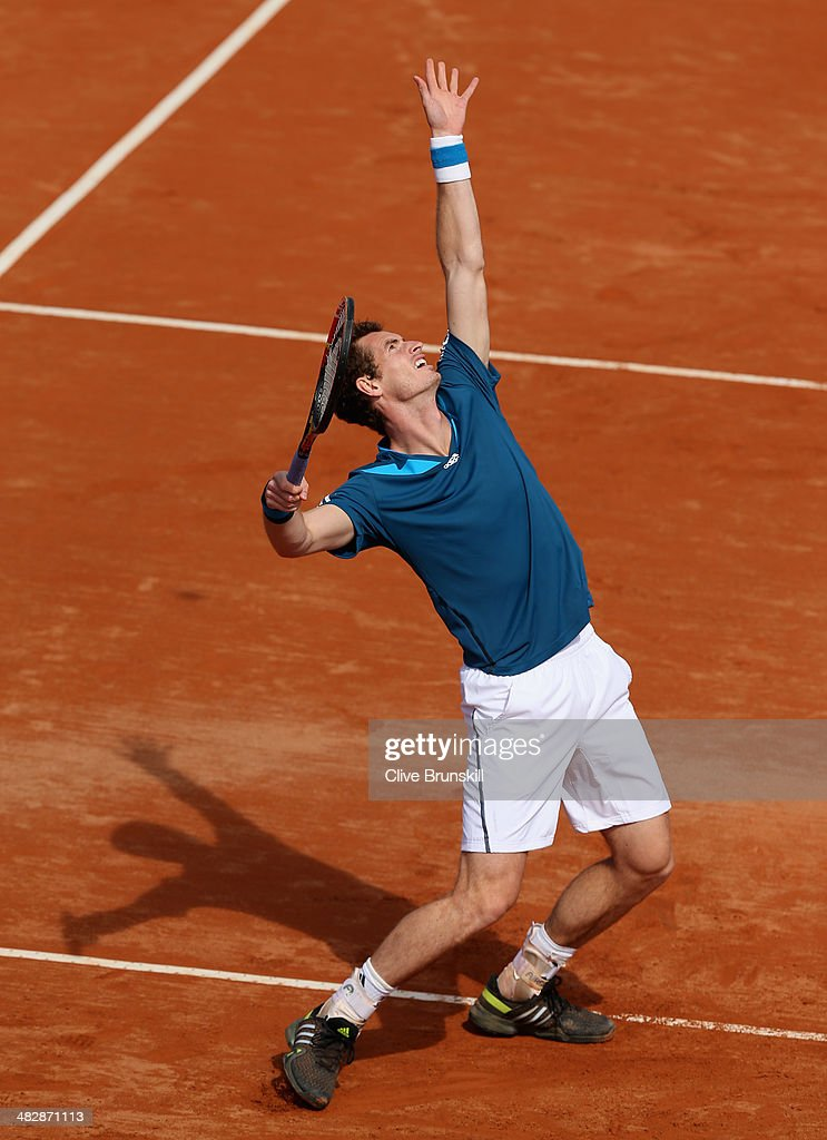 Andy Murray of Great Britain serves against Andreas Seppi of Italy during day two of the Davis Cup World Group Quarter Final match between Italy and Great Britain at Tennis Club Napoli on April 5, 2014 in Naples, Italy.
