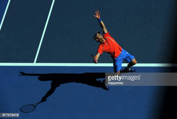 Andy Murray of Great Britain serves against Edouard RogerVasselin of France during a Men's Singles 2nd round match on day four of the 2012 Australian...