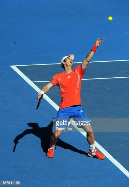 Andy Murray of Great Britain serves against Kei Nishikori of Japan during a Men's Singles quarter final on day ten of the 2012 Australian Open at...