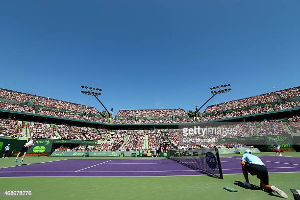 Andy Murray of Great Britain serves against Novak Djokovic of Serbia in the mens final during the Miami Open Presented by Itau at Crandon Park Tennis...