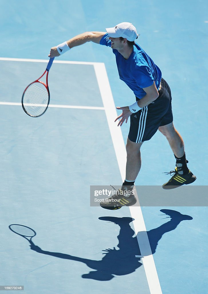 Andy Murray of Great Britain serves during a practice session ahead of the 2013 Australian Open at Melbourne Park on January 11, 2013 in Melbourne, Australia.