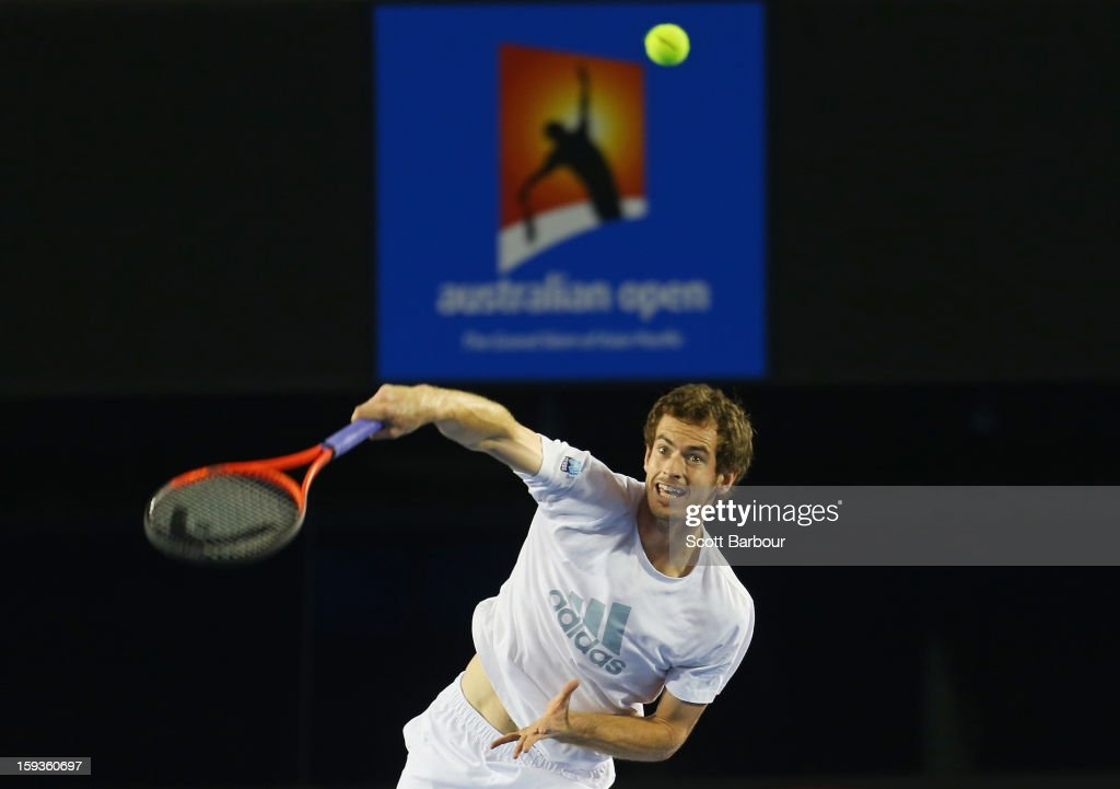 Andy Murray of Great Britain serves during a practice session ahead of the 2013 Australian Open at Melbourne Park on January 13, 2013 in Melbourne, Australia.