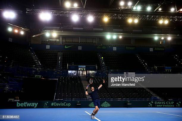 Andy Murray of Great Britain serves during a practice session ahead of the start of the Davis Cup tie between Great Britain and Japan at Barclaycard...