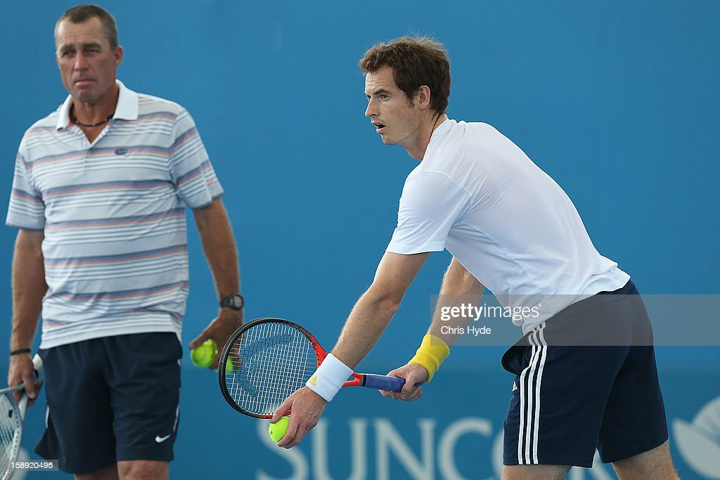 Andy Murray of Great Britain serves during a practice session while his coach Ivan Lendl watches on during day six of the Brisbane International at Pat Rafter Arena on January 4, 2013 in Brisbane, Australia.