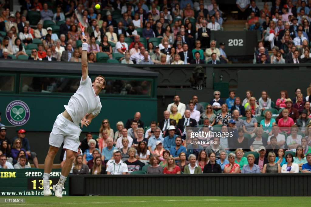 Andy Murray of Great Britain serves during his Gentlemen's Singles first round match against Nikolay Davydenko of Russia on day two of the Wimbledon Lawn Tennis Championships at the All England Lawn Tennis and Croquet Club on June 26, 2012 in London, England.