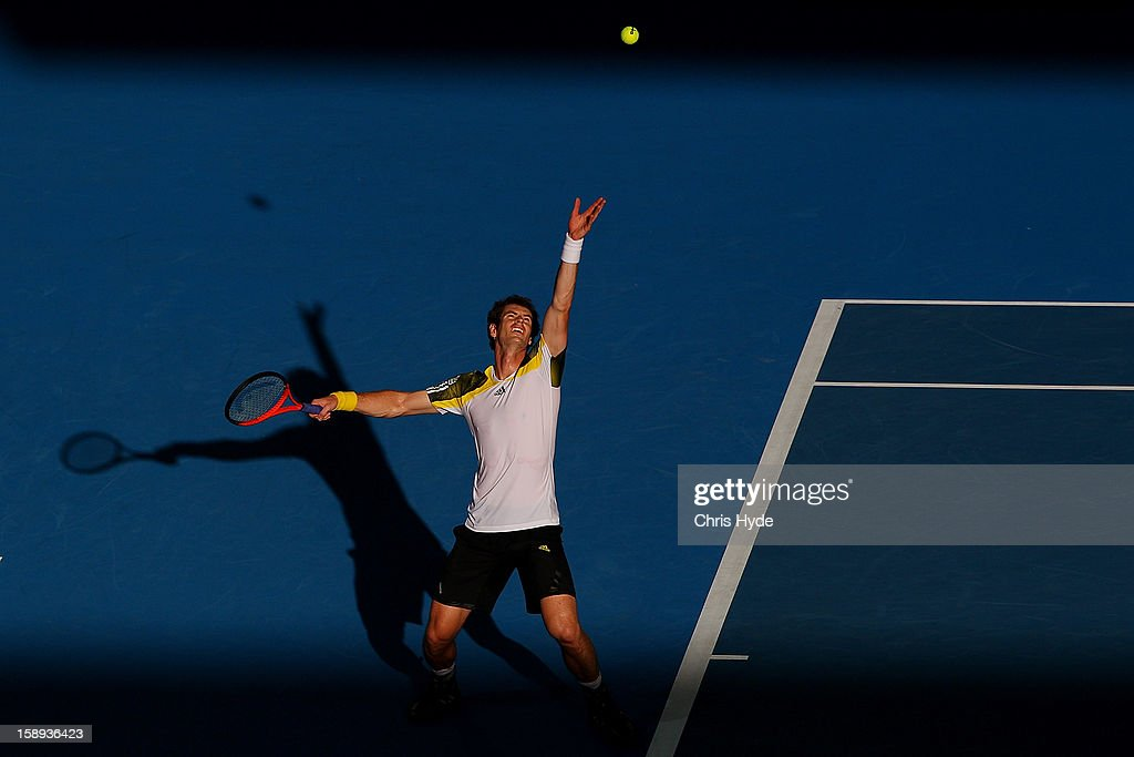 Andy Murray of Great Britain serves during his match against Denis Istomin of Uzbekistan on day six of the Brisbane International at Pat Rafter Arena on January 4, 2013 in Brisbane, Australia.