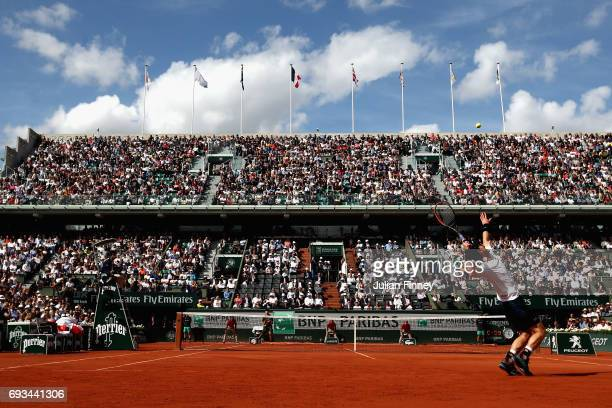 Andy Murray of Great Britain serves during mens singles quarter finals match against Kei Nishikori of Japan on day eleven of the 2017 French Open at...