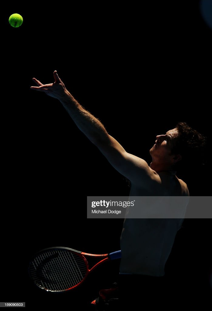 Andy Murray of Great Britain serves during practice ahead of the 2013 Australian Open at Melbourne Park on January 8, 2013 in Melbourne, Australia.