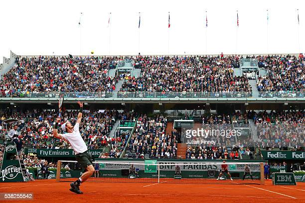 Andy Murray of Great Britain serves during the Men's Singles final match against Novak Djokovic of Serbia on day fifteen of the 2016 French Open at...