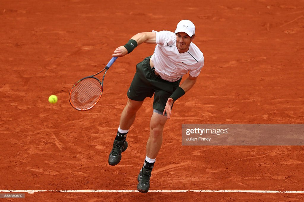 Andy Murray of Great Britain serves during the Men's Singles fourth round match against John Isner of the United States on day eight of the 2016 French Open at Roland Garros on May 29, 2016 in Paris, France.