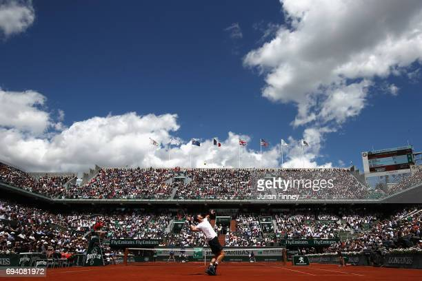 Andy Murray of Great Britain serves during the mens singles semifinal match against Stan Wawrinka of Switzerland on day thirteen of the 2017 French...