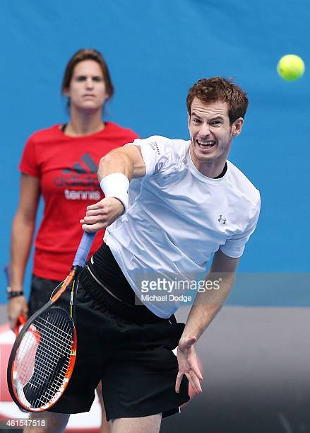 Andy Murray of Great Britain serves in front of coach Amelie Mauresmo during a practice session ahead of the 2015 Australian Open at Melbourne Park...