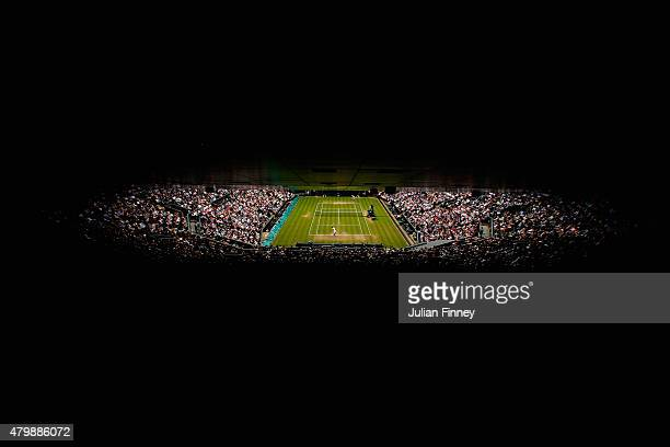 Andy Murray of Great Britain serves in his Gentlemens Singles Quarter Final match against Vasek Pospisil of Canada during day nine of the Wimbledon...
