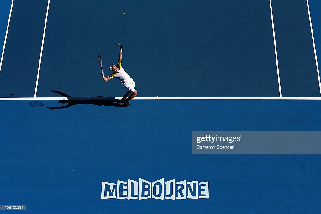 Andy Murray of Great Britain serves in his third round match against Ricardas Berankis of Lithuania during day six of the 2013 Australian Open at Melbourne Park on January 19, 2013 in Melbourne, Australia.