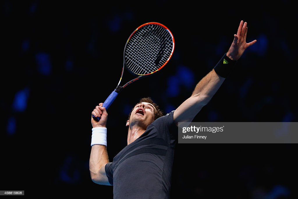 Andy Murray of Great Britain serves in the round robin singles match against Milos Raonic of Canada on day three of the Barclays ATP World Tour Finals at the O2 Arena on November 11, 2014 in London, England
