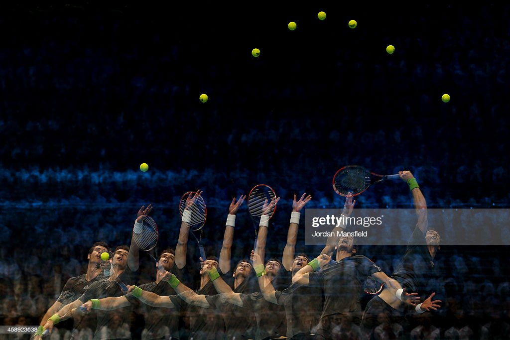 Andy Murray of Great Britain serves in the round robin singles match against Roger Federer of Switzerland on day five of the Barclays ATP World Tour...