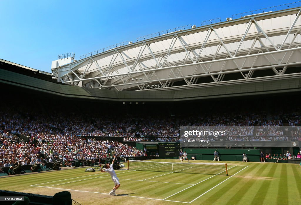 Andy Murray of Great Britain serves on Centre Court during the Gentlemen's Singles Final match against Novak Djokovic of Serbia on day thirteen of...