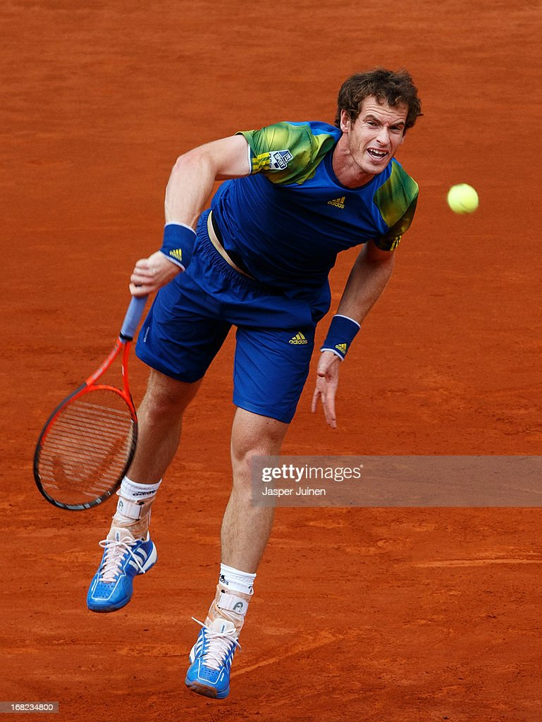 <a gi-track='captionPersonalityLinkClicked' href=/galleries/search?phrase=Andy+Murray+-+Tennis+Player&family=editorial&specificpeople=200668 ng-click='$event.stopPropagation()'>Andy Murray</a> of Great Britain serves the ball to Florian Mayer of Germany during his match on day four of the Mutua Madrid Open tennis tournament at the Caja Magica on May 7, 2013 in Madrid, Spain.