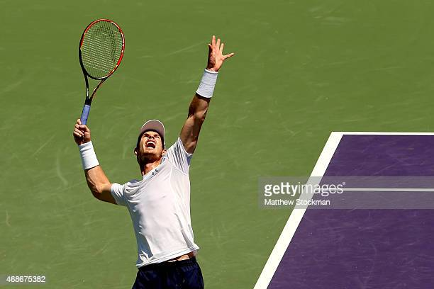 Andy Murray of Great Britain serves to Novak Djokovic of Serbia during the final on day 14 of the Miami Open Presented by Itau at Crandon Park Tennis...