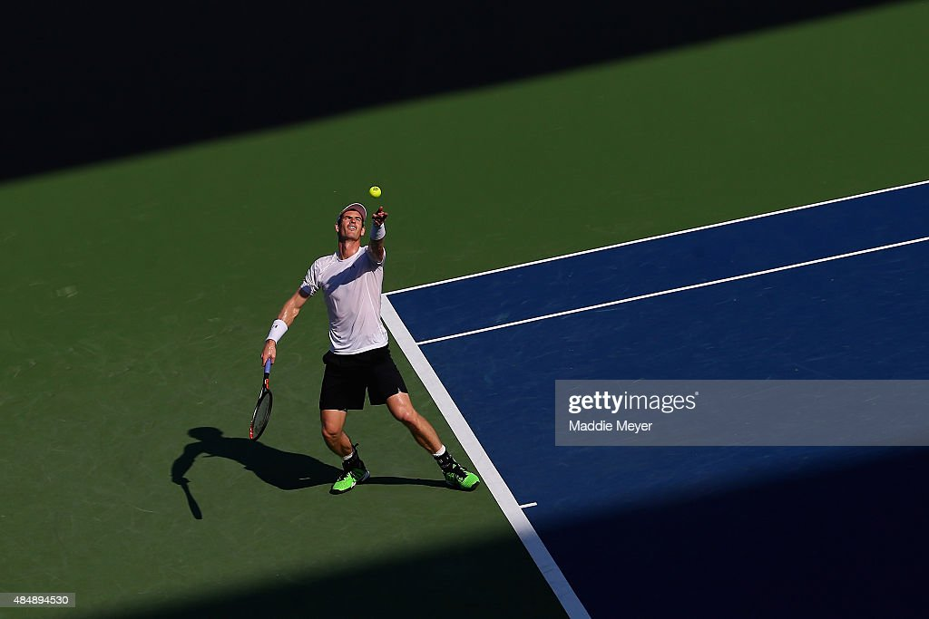 Andy Murray of Great Britain serves to Roger Federer of Switzerland during the semifinals on Day 8 of the Western & Southern Open at the Lindner Family Tennis Center on August 22, 2015 in Cincinnati, Ohio.