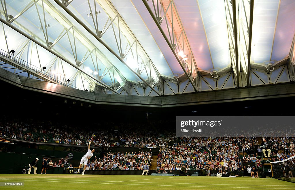 Andy Murray of Great Britain serves under a closed roof on Centre Court during the Gentlemen's Singles semi-final match against Jerzy Janowicz of Poland on day eleven of the Wimbledon Lawn Tennis Championships at the All England Lawn Tennis and Croquet Club on July 5, 2013 in London, England.