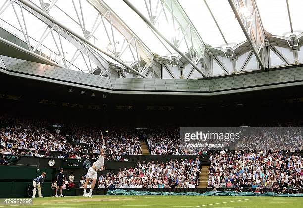 Andy Murray of Great Britain serves under the roof of Centre Court against Vasek Pospisil of Canada during day nine of the Wimbledon Lawn Tennis...