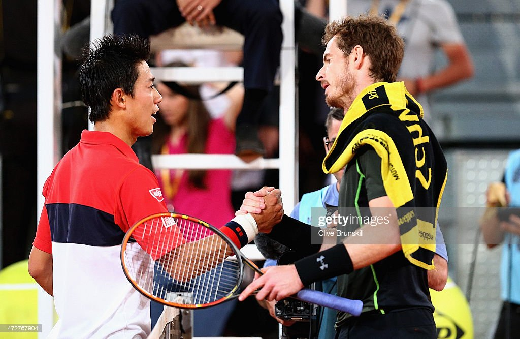 Andy Murray of Great Britain shakes hands at the net after his straight sets victory against Kei Nishikori of Japan in their semi final match during day eight of the Mutua Madrid Open tennis tournament at the Caja Magica on May 9, 2015 in Madrid, Spain.