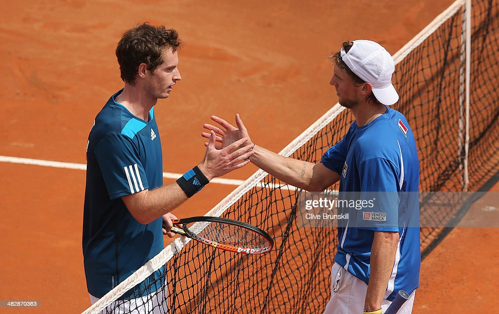 Andy Murray of Great Britain shakes hands at the net after his straight sets victory over against Andreas Seppi of Italy in the second rubber during day two of the Davis Cup World Group Quarter Final match between Italy and Great Britain at Tennis Club Napoli on April 5, 2014 in Naples, Italy.