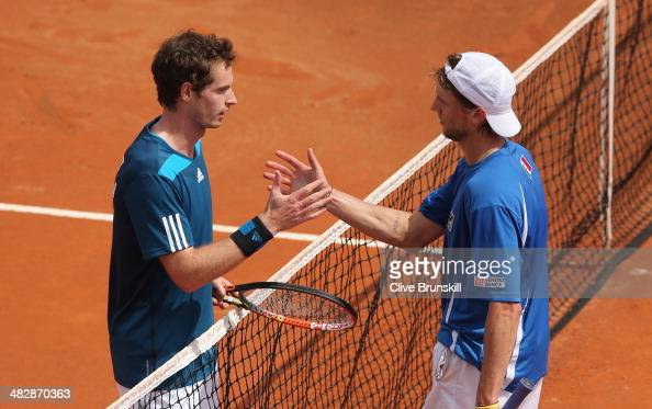 Andy Murray of Great Britain shakes hands at the net after his straight sets victory over against Andreas Seppi of Italy in the second rubber during...