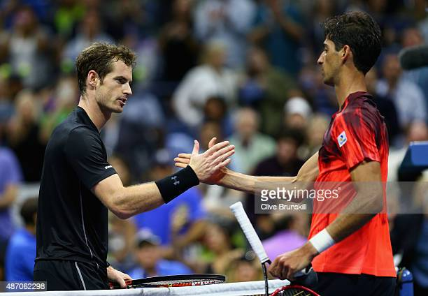Andy Murray of Great Britain shakes hands at the net after his straight sets victory against Thomaz Bellucci of Brazil during their mens singles...