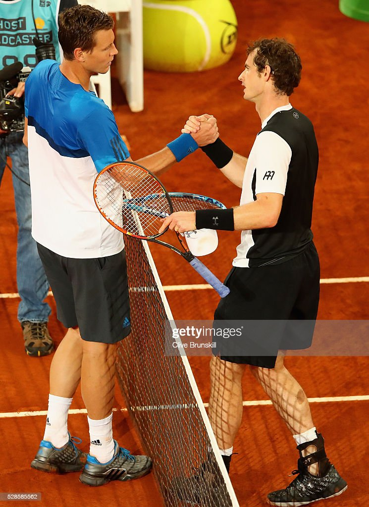 <a gi-track='captionPersonalityLinkClicked' href=/galleries/search?phrase=Andy+Murray+-+Tennisspelare&family=editorial&specificpeople=200668 ng-click='$event.stopPropagation()'>Andy Murray</a> of Great Britain shakes hands at the net after his straight sets victory against <a gi-track='captionPersonalityLinkClicked' href=/galleries/search?phrase=Tomas+Berdych&family=editorial&specificpeople=239147 ng-click='$event.stopPropagation()'>Tomas Berdych</a> of the Czech Republic in their quarter final round match during day seven of the Mutua Madrid Open tennis tournament at the Caja Magica on May 06, 2016 in Madrid,Spain.