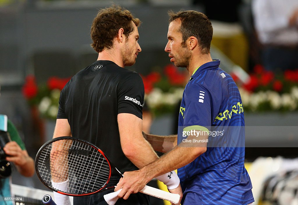 Andy Murray of Great Britain shakes hands at the net after his three set victory against Radek Stepanek of the Czech Republic in their second round match during day four of the Mutua Madrid Open tennis tournament at the Caja Magica on May 03, 2016 in Madrid,Spain.