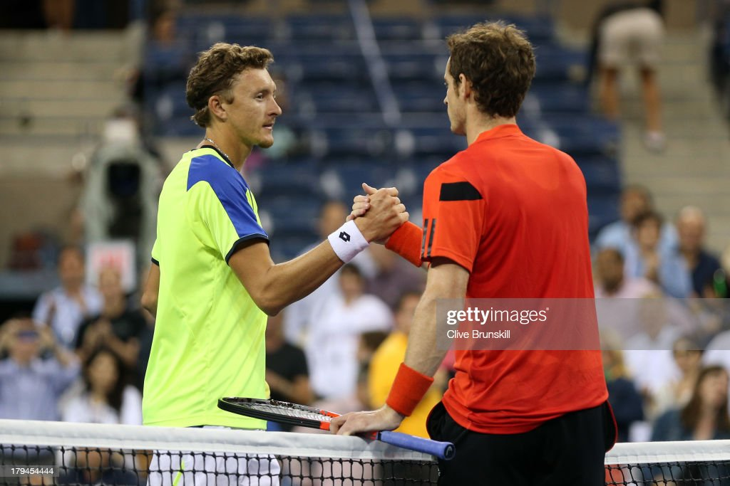 Andy Murray of Great Britain shakes hands at the net with Denis Istomin of Uzbekistan after their men's singles fourth round match on Day Nine of the 2013 US Open at USTA Billie Jean King National Tennis Center on September 3, 2013 in the Flushing neighborhood of the Queens borough of New York City.
