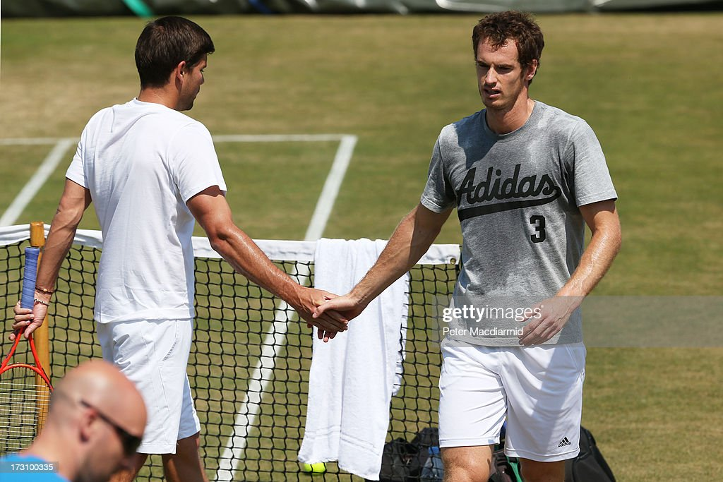 Andy Murray of Great Britain shakes hands with Danny Vallverdu during a practice session ahead of his Gentlemen's Singles final match aginst Novak Djokovic of Serbia on day thirteen of the Wimbledon Lawn Tennis Championships at the All England Lawn Tennis and Croquet Club at Wimbledon on July 7, 2013 in London, England.