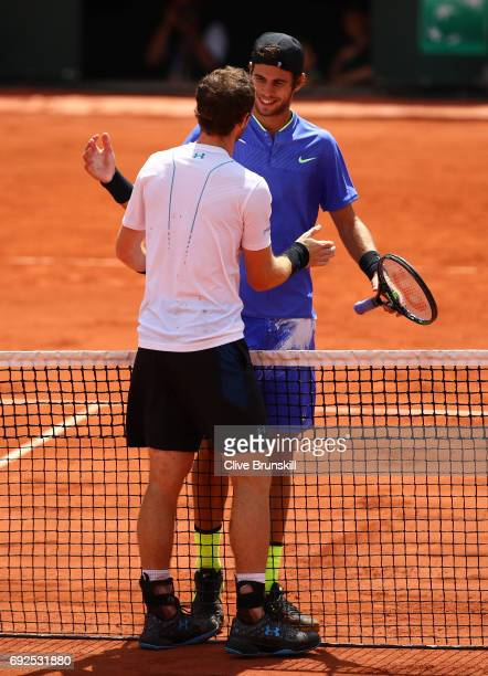 Andy Murray of Great Britain shakes hands with Karen Khachanov of Russia following victory during their men's singles fourth round match on day nine...