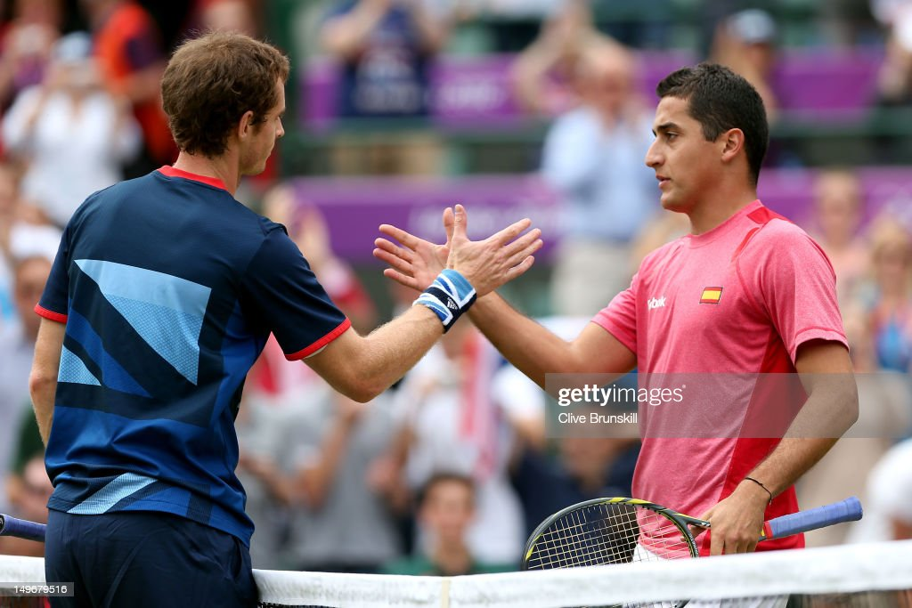 Andy Murray of Great Britain shakes hands with Nicolas Almagro of Spain after defeating him in the Quarterfinal of Men's Singles Tennis on Day 6 of...