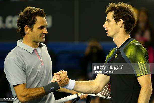 Andy Murray of Great Britain shakes hands with Roger Federer of Switzerland after Murray won their semifinal match during day twelve of the 2013...