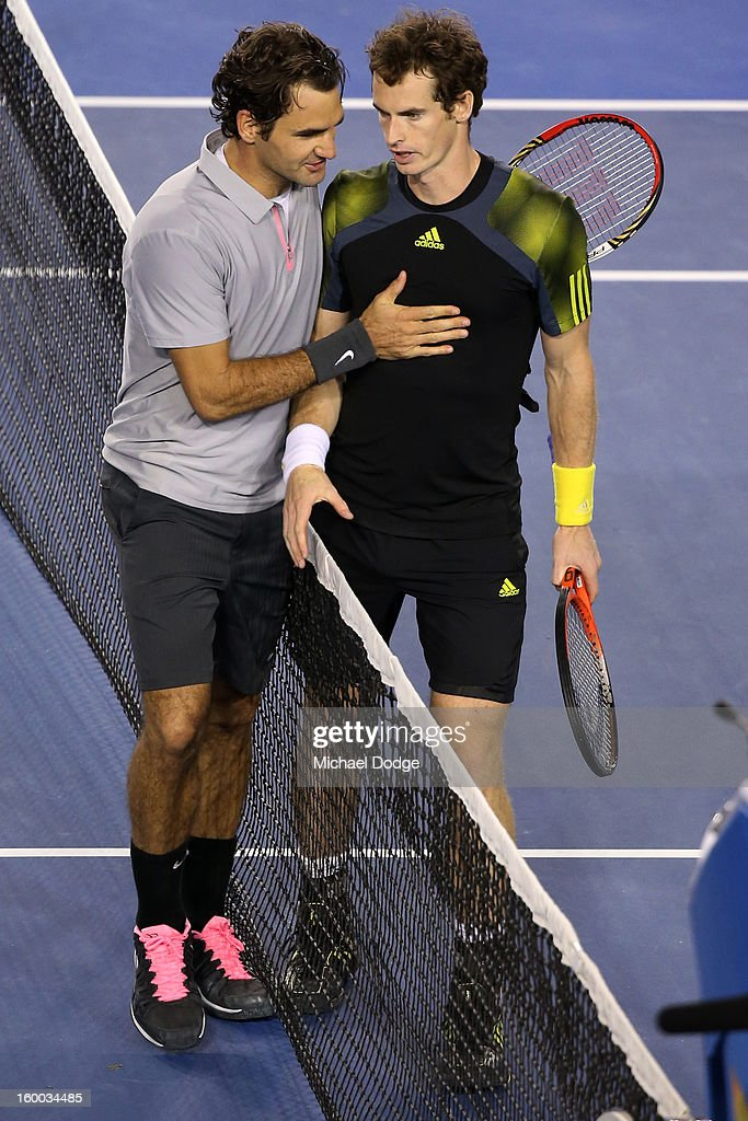 <a gi-track='captionPersonalityLinkClicked' href=/galleries/search?phrase=Andy+Murray+-+Tennis+Player&family=editorial&specificpeople=200668 ng-click='$event.stopPropagation()'>Andy Murray</a> of Great Britain shakes hands with <a gi-track='captionPersonalityLinkClicked' href=/galleries/search?phrase=Roger+Federer&family=editorial&specificpeople=157480 ng-click='$event.stopPropagation()'>Roger Federer</a> of Switzerland after Murray won their semifinal match during day twelve of the 2013 Australian Open at Melbourne Park on January 25, 2013 in Melbourne, Australia.