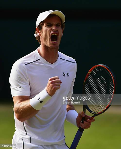 Andy Murray of Great Britain shouts as he celebrates winning a point during the Gentlemens Singles Semi Final match against Roger Federer of...