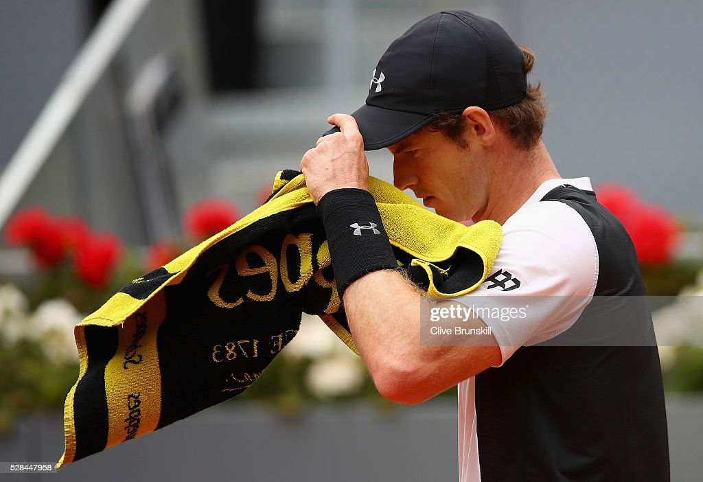 Andy Murray of Great Britain shows his dejection against Gilles Simon of France in their third round match during day six of the Mutua Madrid Open tennis tournament at the Caja Magica on May 05, 2016 in Madrid,Spain